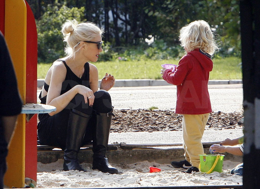 Gwen sat with Zuma in the sandbox.