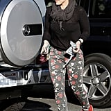 Hilary Duff made her way around the car.