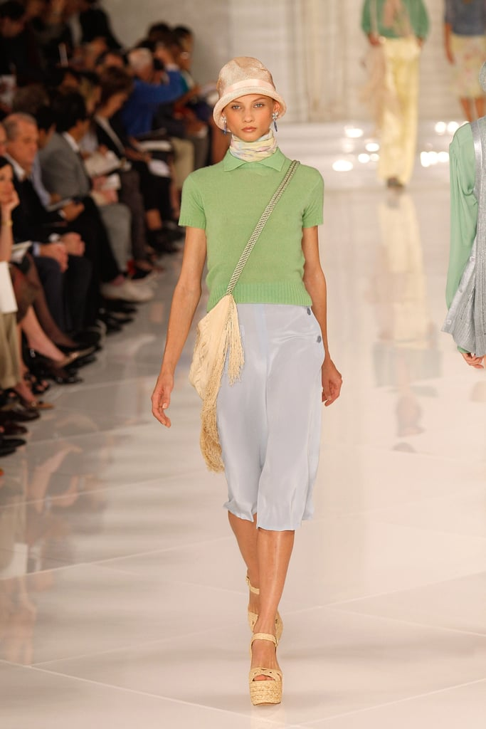 >> This season, Ralph Lauren returned to classic Americana, trotting out a solid collection of '20s-tinged separates and eveningwear. In short, it was what a modern-day Daisy Buchanon would wear to a garden party. She'd have plenty of options to choose from — flowy crepe de chine trousers in peach and baby blue, chiffon skirts in sherbet-florals, and cashmere sweaters in daffodil and apple green.   For evening, there were high-shine gowns in panne velvet, slip-dresses with deco beading, and ostrich feather shrugs. Also, three-piece suits in ivory silk, complete with pink-satin ties. If all this sounds familiar, it should. After all, it was Ralph Lauren who designed the costumes for the 1974 film The Great Gatsby, and many of those knockout silhouettes were reprised here.