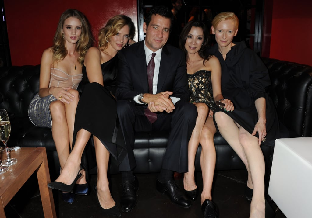 Clive Owen was the man in the middle last night when he celebrated the launch of Vertu's Constellation smartphone at Milan's Palazzo Serbelloni with Uma Thurman, Rosie Huntington-Whiteley, Tilda Swinton, and Michelle Yeoh. Earlier in the day, Clive accompanied a guy pal for a bit of shopping. By the evening, Clive was in his dapper suit to mingle with other friends of the luxury communication company. It's certainly an exclusive brand — the gold version of the Constellation handset retails for $27,000, and the base model starts at $8,400! They've also collaborated in the past with Ferrari on a $25,400 phone. Clive might not have to buy his own model, but things are going well for him professionally. Millennium just picked up Intruders, Clive's thriller from Spanish director Juan Carlos Fresnadillo, for distribution in the US with a planned release date in April.
