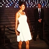 Helena Christensen posed in a pretty Spring white Marc by Marc Jacobs frock, complete with an ultragirlie scalloped hem.