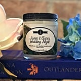 Jamie and Claire's Wedding Night candle ($16) with notes of white roses, vanilla, citrus, and jasmine.