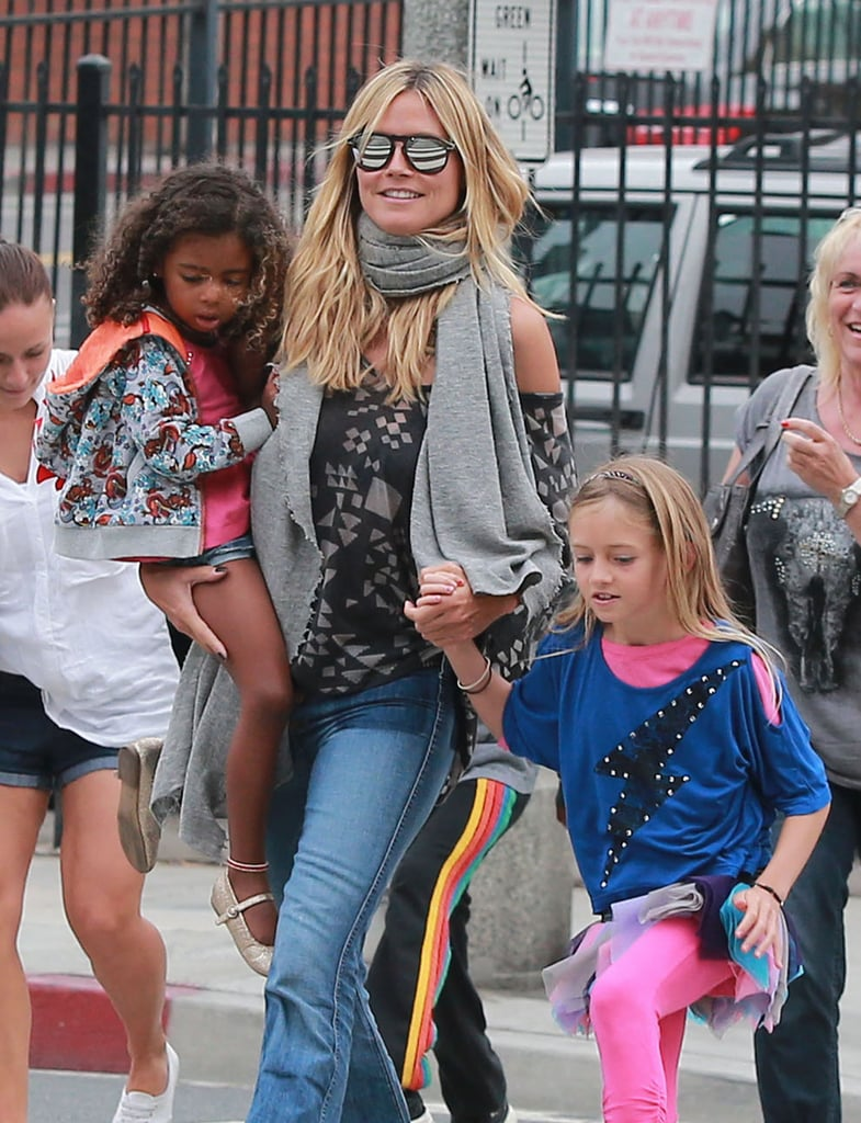 On Sunday, Heidi Klum held onto her daughters, Leni and Lou Samuel, after a family lunch in LA.