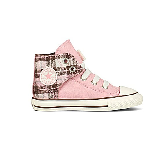 Her feet will stay warm when she slips on these pink flannel Chuck Taylors ($37).