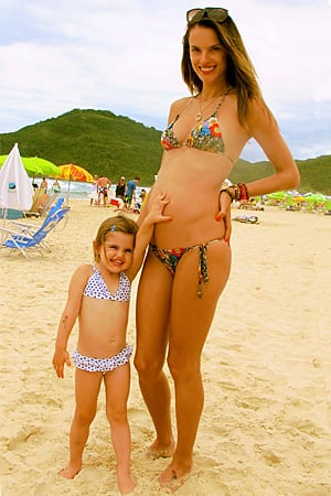 Alessandra Ambrosio shared a picture of herself pregnant and in a bikini on the beach with her daughter Anja. Source: Twitter user angelalessandra