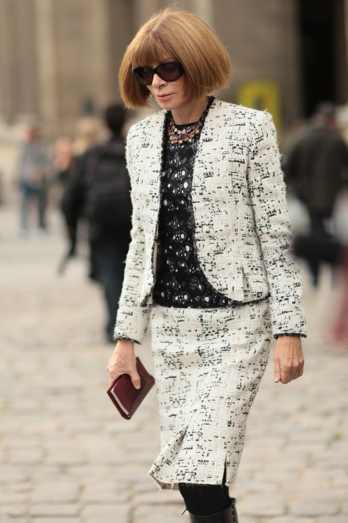 The chicest tweed suit, with a touch of Anna's signature jewels at the collar.