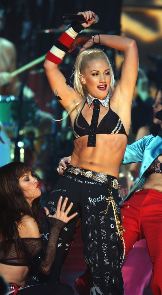 Gwen Stefani showed off her stomach during a 2001 performance.
