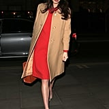Red is definitely Amal's color, and she keeps it understated with a camel Balmain overcoat.