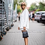 Pair short shorts with a blazer and flats to give them more polish.
