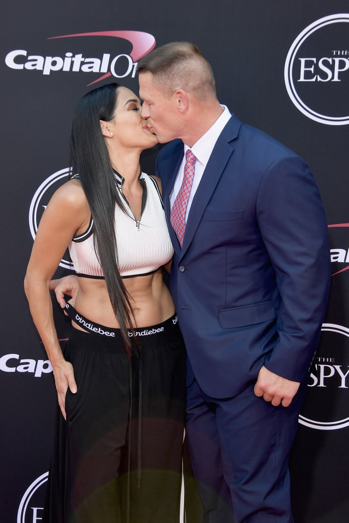 "John Cena and Nikki Bella ended their six-year relationship in April, and fans are devastated. Not only did the couple first meet on WWE, but they even got engaged at WrestleMania 33 and throughout their relationship, the two gave us several adorable displays of their crazy-hot chemistry. Whether they were sharing a red carpet moment or enjoying one of their over-the-top date nights, John and Nikki's time together wasn't your average love story.  Related: John Cena Has Known He Wanted to Marry Nikki Bella For ""a Long, Long Time"""