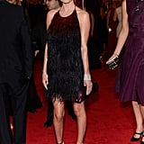 Kate Bosworth Pairs a Bold Lip With Her Feathered Prada Gown at the Met Gala