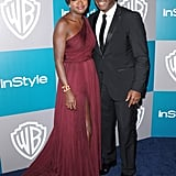 Viola Davis and Julius Tennon keep close on their way into the fun.