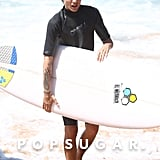 Louis Tomlinson carried his surfboard after taking a dip in the ocean.