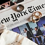 Tip: Using a newspaper to showcase your rings is a great way to remember your wedding date. Photo by Everly Studios