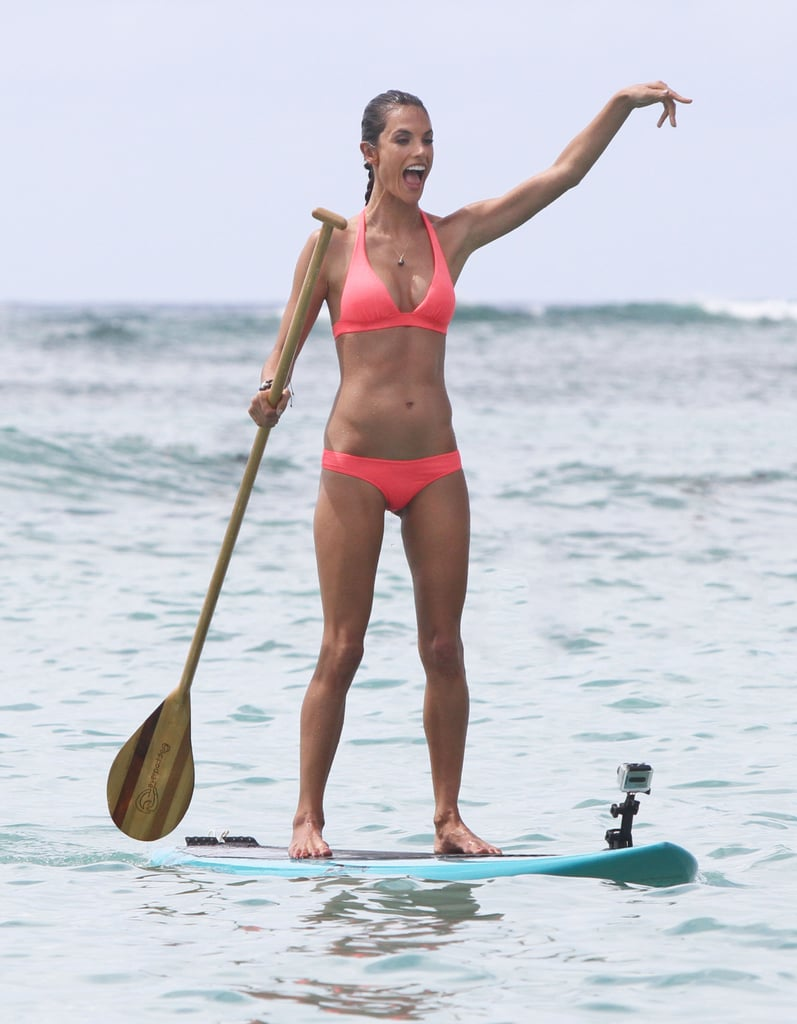 Alessandra Ambrosio paddle boarding in Hawaii.