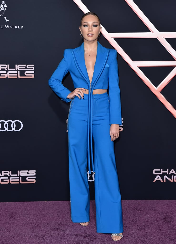 Maddie Ziegler looked ready to work for the Townsend Agency in her badass suit at the Charlie's Angels premiere in Los Angeles. The singer and West Side Story actress attended the red carpet event on Monday wearing an electric blue outfit by Area.  Maddie's trousers featured rhinestone embellishments on the side, while her blazer had an interesting piping detail that truthfully resembled Avatar's Na'vi creatures and their tails — and we mean that in the coolest way possible. Maddie was also joined by her sister, singer Kenzie Ziegler, who wore a sparkly strapless dress from Abyss by Abby. See photos of the stylish sisters ahead, and get a closer look at Maddie's unique suit.