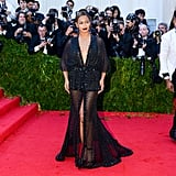 Wearing a black beaded Givenchy dress to the Met Gala in 2014.