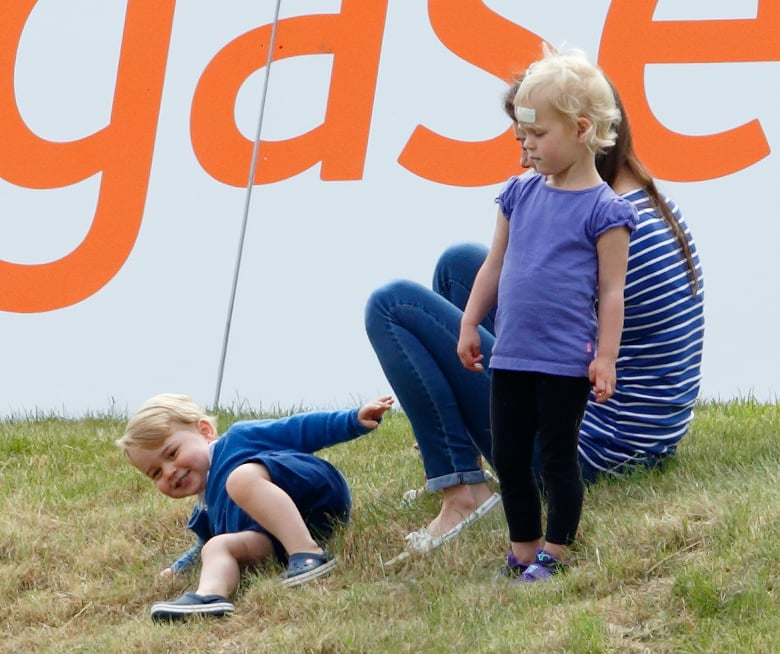 Prince George wasn't the only cute kid hanging out at Prince William's polo match in Tetbury, England, on Sunday. Among Kate Middleton and Prince George's many adorable moments throughout the day were some supersweet interactions with his little cousins. Zara Phillips and her husband, Mike Tindall, brought their little girl, Mia, to the match, and Zara's brother, Peter, was also there with his wife, Autumn, and their two daughters, Savannah and Isla. Prince George was all smiles while playing in the grass with Isla, and at one point, Kate made her way over to Zara to chat and say hi to baby Mia. Keep reading for all the best pictures of Prince George's fun day, then see the cutest snaps of his balcony debut, which looked an awful lot like Prince William's debut in 1984.