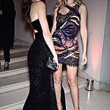 Gigi posed with Kendall inside the party, Kendall's red hot lipstick complementing the bright orange on Gigi's dress and shoes.