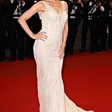 Kylie Minogue posed confidently in her plunging neutral Roberto Cavalli gown and drop earrings at the Les Saludes premiere at Cannes.