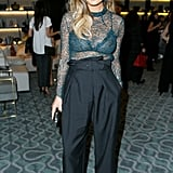 At a dinner in West Hollywood, Chrissy kept it supersexy in a bra-baring sheer top and high-waisted Stella McCartney trousers.