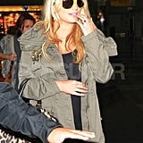 Jessica Simpson smiled at the airport in NYC.