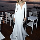 Petra Nemcova's long white gown hugged all her curves as she posed by the water.