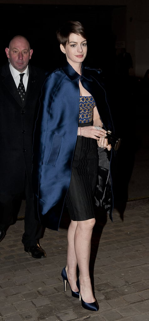Anne headed into the London after-party for her film in a cape-adorned Altuzarra strapless dress.