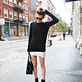 Not quite cold enough for tights yet — we love this way to take a miniskirt from Summer to Fall and make it more daytime-appropriate with a slouchy sweater on top. Source: Lookbook.nu