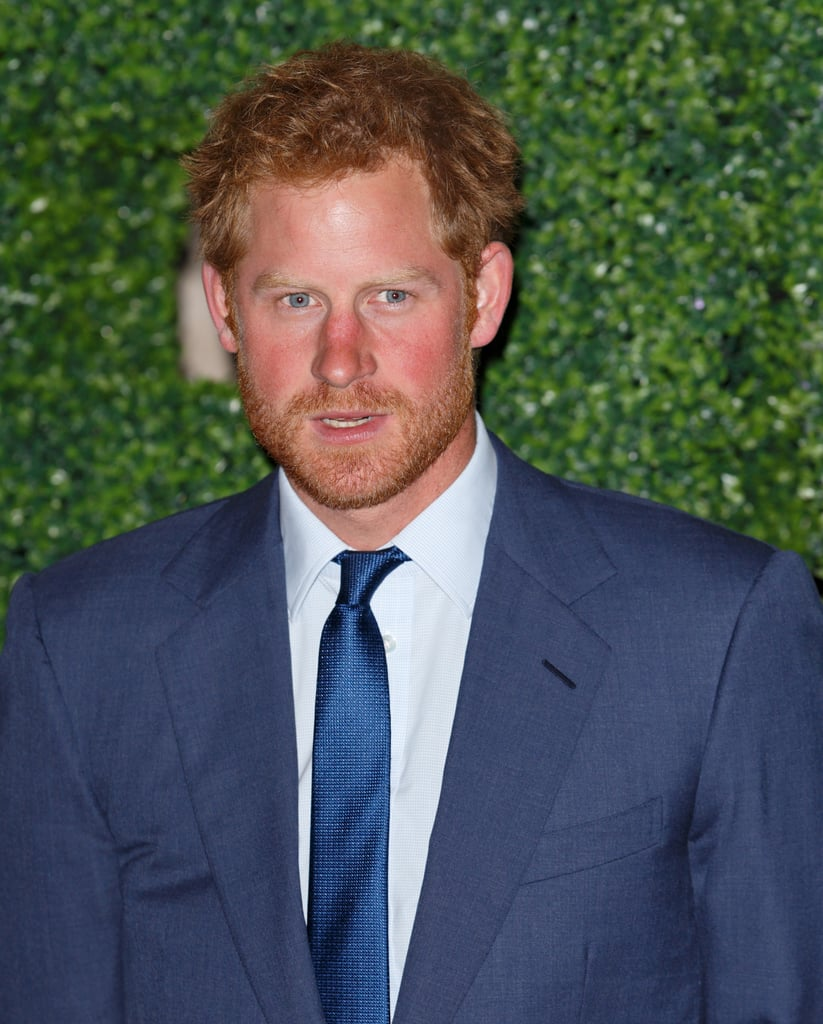 Prince Harry Steps Out With His Scruff, His Suit, And His