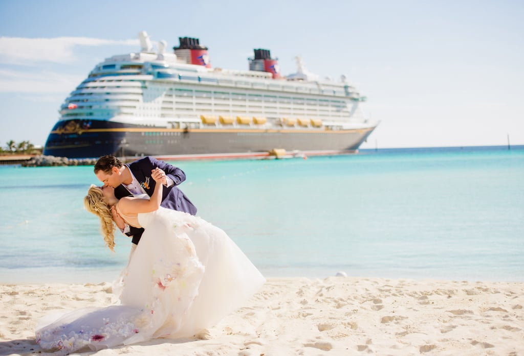 """Five days aboard a Disney cruise, surrounded by 100+ family members and friends. A Little Mermaid-themed ceremony on a private island, and the magic of Disney woven throughout the whole affair. Welcome to Colette and Johnny's wedding week. The couple met because they both worked in the video games industry. At the time, John was the VP of Production on the video game """"Disney Infinity"""" in LA, and Colette was working as a video games PR professional in London, but also blogged about video games on the side as a hobby. Colette published an article about Johnny's video game, and the article caught his attention. He subsequently met her in London during a press tour and showed her the game in-person. The two connected very quickly, sharing a passion for video games and all things Disney. """"When we met, I knew she was the one. Colette is smart, creative, funny, hard working, a great talker, courageous, and drop dead gorgeous!"""" Johnny told POPSUGAR. Related: This Couple Rented Out Toy Story Mania For Their Disneyland Wedding, So We Can Stop Trying Now The distance between the two didn't stop them from falling deeply in love with each other over time. Despite the eight-hour time difference, the two made things work as best as they could. In February 2016, Johnny and Colette both took a four-day cruise aboard the Disney Dream and celebrated Valentine's Day together on Disney's private island, Castaway Cay. At the end of this trip, these two long-distance love birds decided that they would no longer spend time away from each other and would figure out a way to close the distance between them. After Johnny and Colette took that fateful cruise on Valentines Day 2016 and promised to """"close the gap,"""" they started making plans for the rest of the year. One of the holidays that they had promised to spend time together was Christmas and New Year's — which Johnny secretly felt was the perfect time to propose to Colette! Leading up to the proposal, both Johnny and Colette were so excit"""