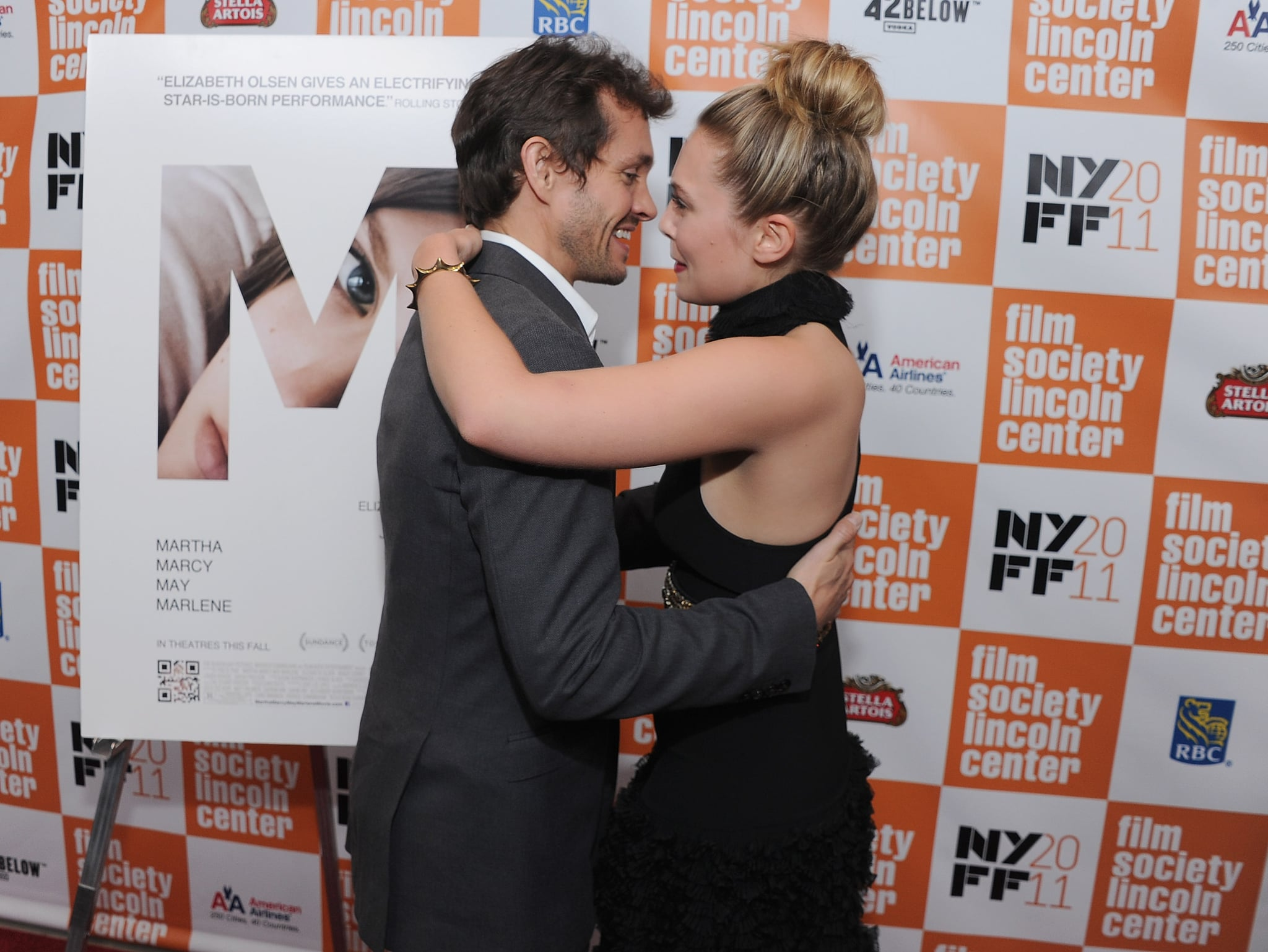 Hugh and Lizzie hugged when they met on the carpet.