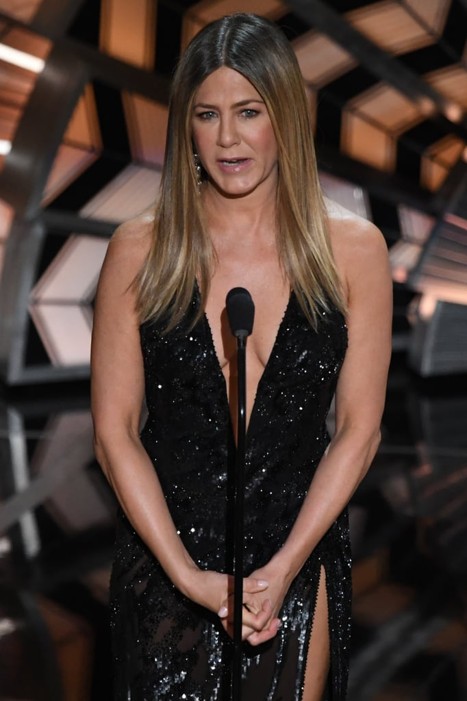 The biggest stars in Hollywood graced the red carpet at the 89th Academy Awards, but there was one person who was missing in action: Jennifer Aniston! The beloved star opted to skip the carpet, but showed up to present at the main event in a embellished black Versace gown with a plunging neckline to finish off what may just be her sultriest look to date. See her stunning look from all angles ahead.
