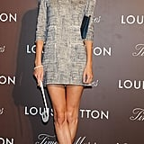 While little sis Cara was in China, Poppy Delevingne was over in Japan attending a Louis Vuitton party in a mini and peacock-blue sandals.
