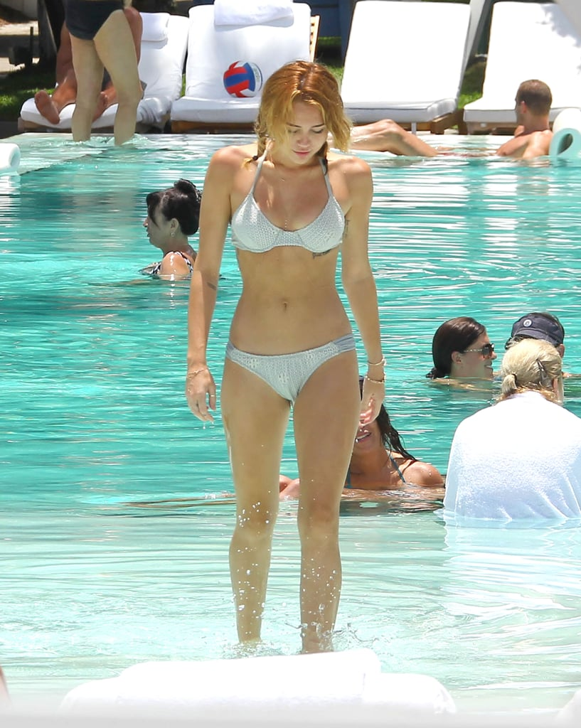 Miley got out of the pool after taking a dip in a bikini in Miami.