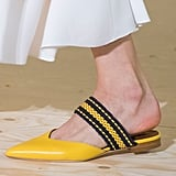A sporty-striped flat with a pointed toe.