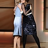 Jessica Alba and Tory Burch hugged on stage.