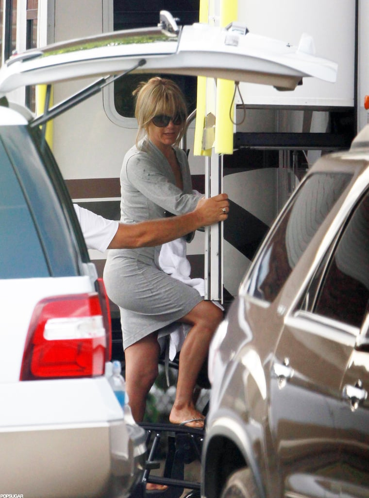 "Jennifer Aniston was in character on the Wilmington, NC, set of We're the Millers yesterday. Jen returned to work after an exciting weekend — Jennifer Aniston's engaged! Jen accepted her now fiancé Justin Theroux's proposal on Friday, his 41st birthday. His rep confirmed the happy news with a statement that read, ""Justin Theroux had an amazing birthday on Friday, receiving an extraordinary gift when his girlfriend, Jennifer Aniston, accepted his proposal of marriage."" We're celebrating their big news with a look at Jen and Justin's sweetest moments."