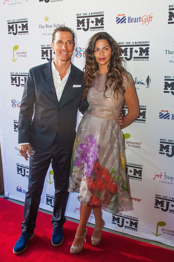 Matthew McConaughey and Camila Alves were glowing on the red carpet in Austin yesterday. The couple posed for pictures on their way into ACL Live at The Moody Theater, where Matthew, in his blue suede shoes, introduced a performance by John Mellencamp. The gala concert was part of a two-day charity event, which continues today, put on by the Mack, Jack & McConaughey foundation. Matthew and Camila teamed up with University of Texas head football coach Mack Brown and his wife, Sally, and singer Jack Ingram and his wife, Amy, to create the organization, which supports programs for underserved children. The event was the group's first fundraising effort since joining together late last year, and they'll be back in the spotlight today with a Celebrity Classic Golf Tournament and at a special Lela Rose fashion show at Neiman Marcus.