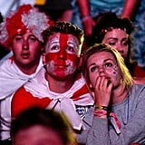Fans watched the game between England and Italy at a park in Newport, England.
