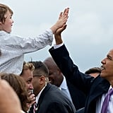 Giving a high five to a child while visiting Kansas City, MO, in 2010.