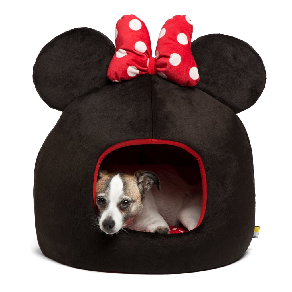 There are dog beds, and then there are dog beds complete with Mickey Mouse ears. We don't know about you, but the latter is definitely our style.  Disney just released a super cute collection of Mickey Mouse-inspired products ranging from pet bowls to pet-friendly throw blankets sure to please even the most die-hard Disney fans. Better yet, the line debuts just in time to celebrate Mickey Mouse's 88th birthday on Nov. 18! Scroll through to make your picks for your holiday wish list.