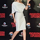 The off-the-shoulder detail, body-con skirt, the icy cool hue — it all adds up to one hot Cameron Diaz (in Victoria Beckham Collection) moment.