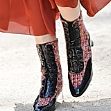 Patent and tweed trimmed boots completed the looks