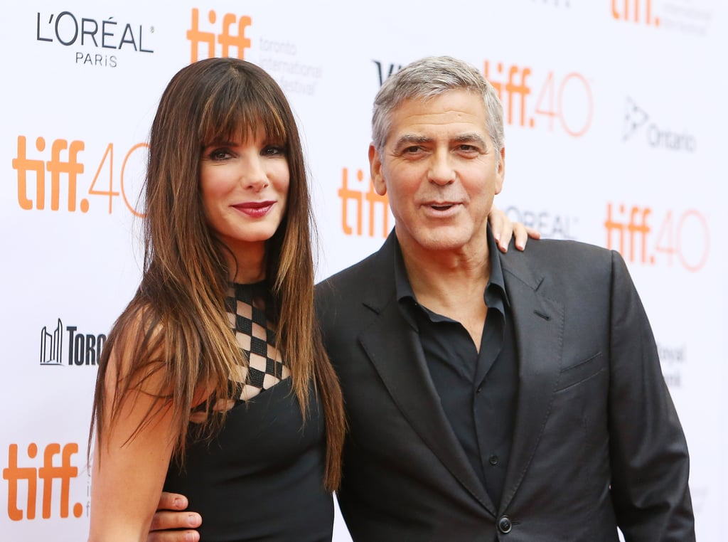 "Sandra Bullock and George Clooney could not have been any cuter at the Our Brand Is Crisis premiere at the Toronto International Film Festival on Friday. Sandra looked hotter than ever in a sexy black dress, while George suited up for a dapper appearance. The long-time friends had some fun on the red carpet, sharing some laughs and posing for photos together. George's latest appearance comes a few days after he sat down with Stephen Colbert on The Late Show With Stephen Colbert, where he revealed what it's like to be his wife Amal's ""arm candy."" Read on to see the best moments from the red carpet, and then check out 11 surprising facts about George!"