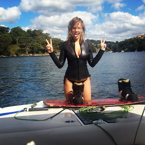 Lara went wakeboarding, one of her favourite pastimes, in a tight wetsuit.