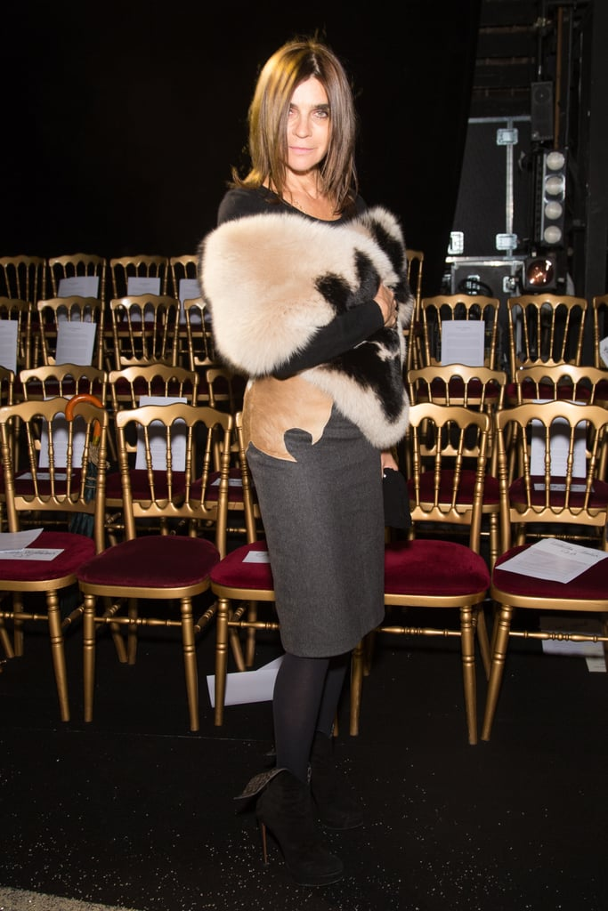 Carine Roitfeld exuded sexy glamour at the Ulyana Sergeenko show in a fur shrug and a gray pencil skirt.