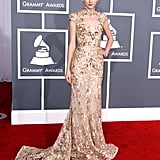 Swift's 2012 Grammy look was anything but boring. Her jaw-dropping Zuhair Murad lace confection — comprised of a high-collar, capped sleeves, and sexy back cutouts — did not hit a single dull note.