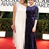 Busy Philipps and Michelle Williams were best friends on thre red carpet at the 2012 Golden Globe Awards.