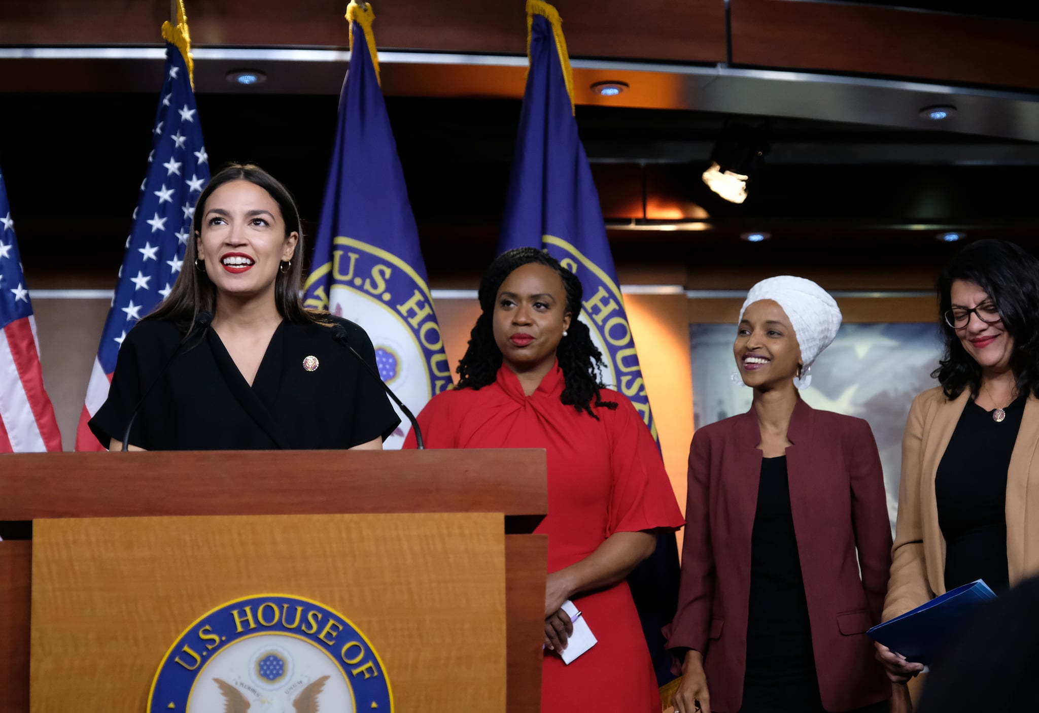 WASHINGTON, DC - JULY 15: U.S. Rep. Alexandria Ocasio-Cortez (D-NY) speaks as Reps. Ayanna Pressley (D-MA), Ilhan Omar (D-MN), and Rashida Tlaib (D-MI) listen during a press conference at the U.S. Capitol on July 15, 2019 in Washington, DC. President Donald Trump stepped up his attacks on four progressive Democratic congresswomen, saying if they're not happy in the United States